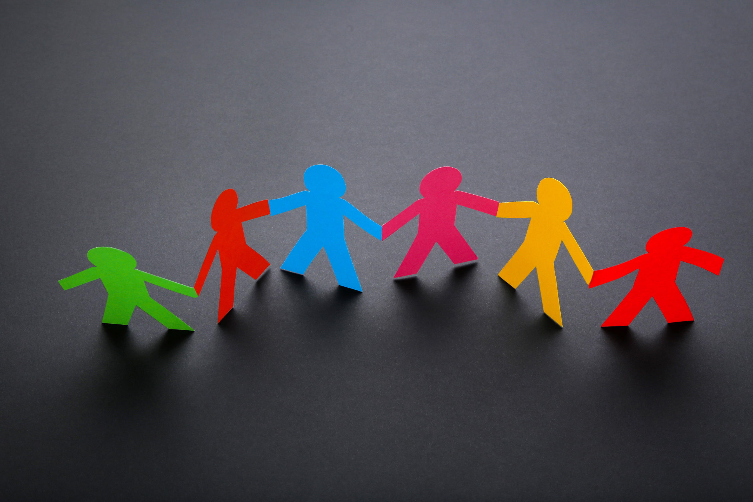 Colourful paperchain family of people holding hands
